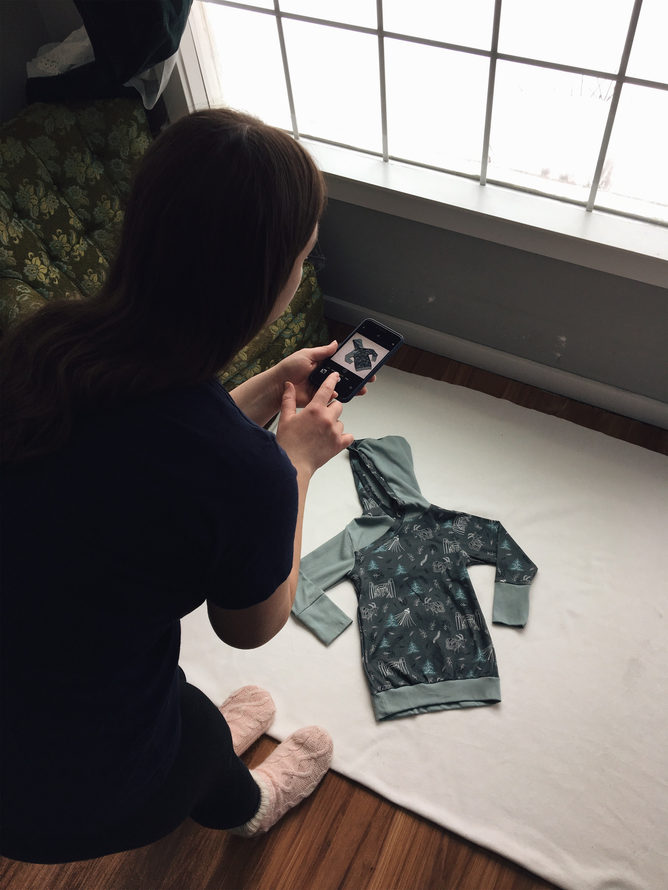 Woman taking a product photo with an iPhone.
